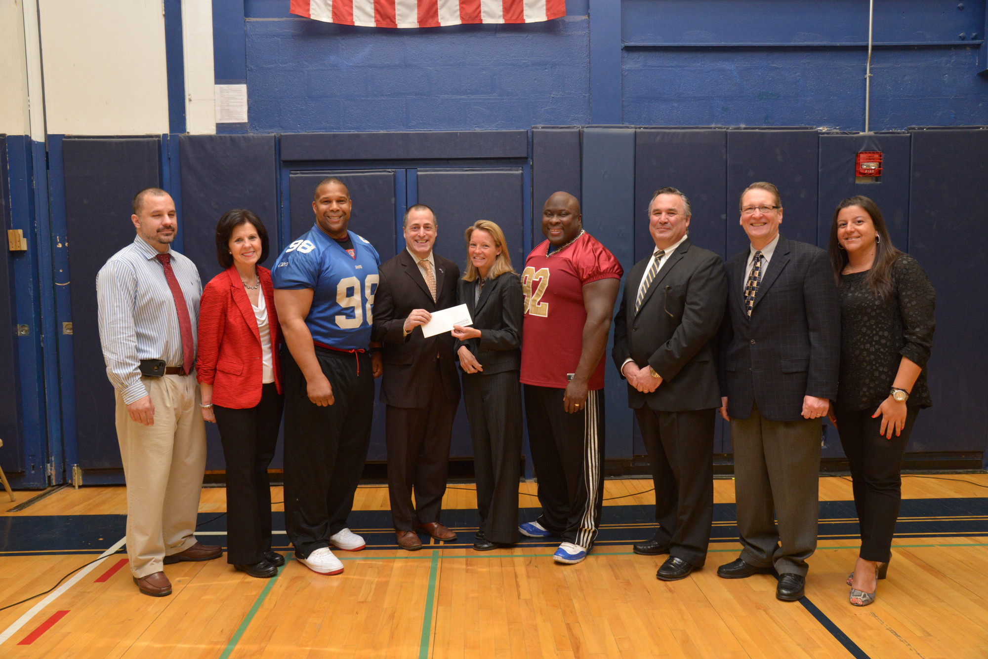 Ed Ramirez, BHS Athletic Director, left, with Pat Banhazl (School to Careers administrator), Keith Davis, Assemblyman Brian Curran, Molloy College Athletic Director Susan Cassidy-Lyke, Clarence Lee, Jim Scannell, Richard Miskiewicz (BHS assistant principal) and Helen Kanellopoulas. Molloy was presenting a check to BHS.