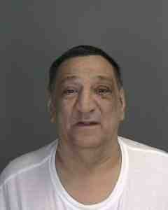 Long Beach police arrested Morris Santaniello and charged him with second-degree burglary on Wednesday.