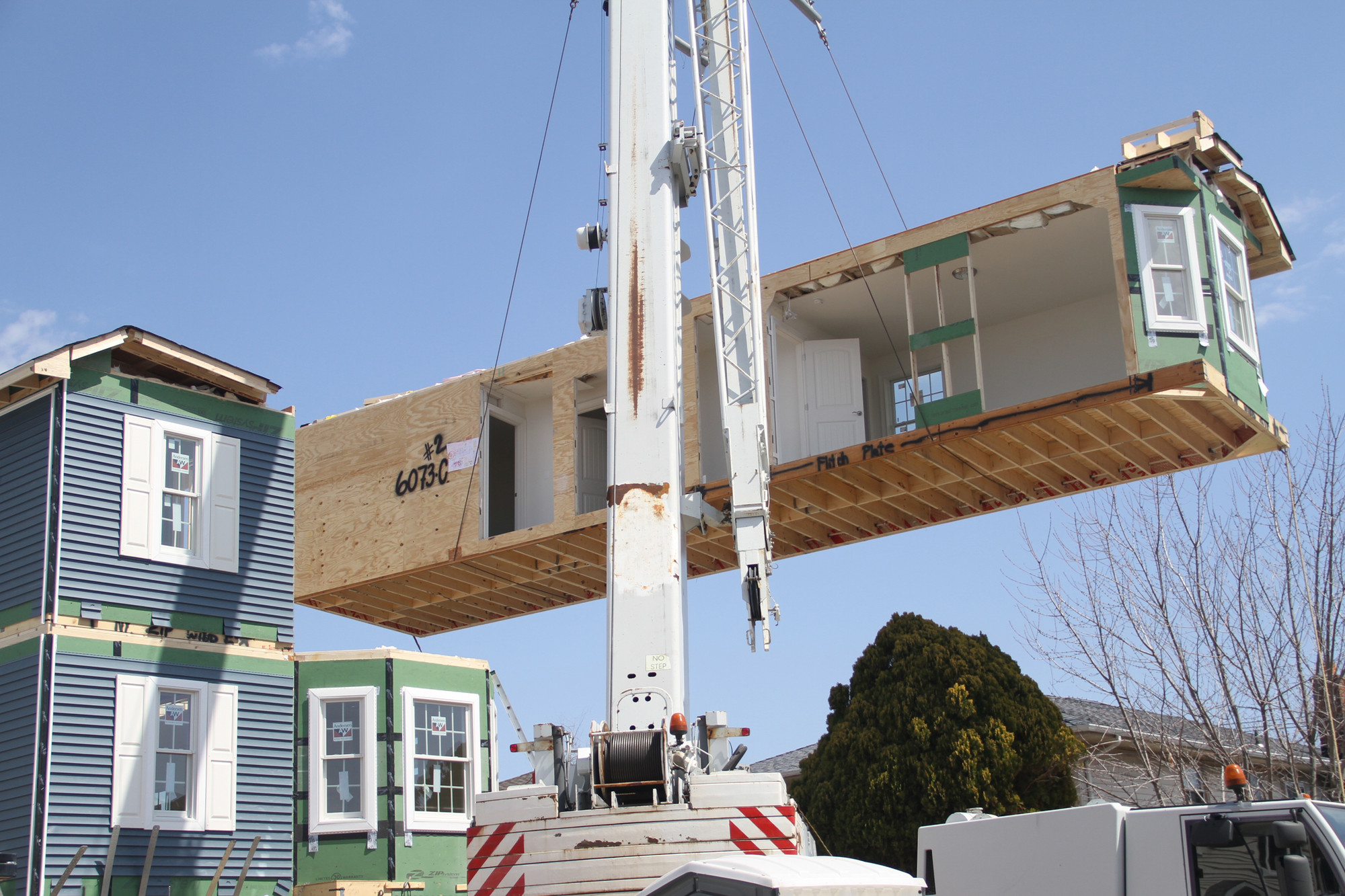 The house arrived in four parts, and installation of the modular home on East Fulton Street was mostly completed in a day.