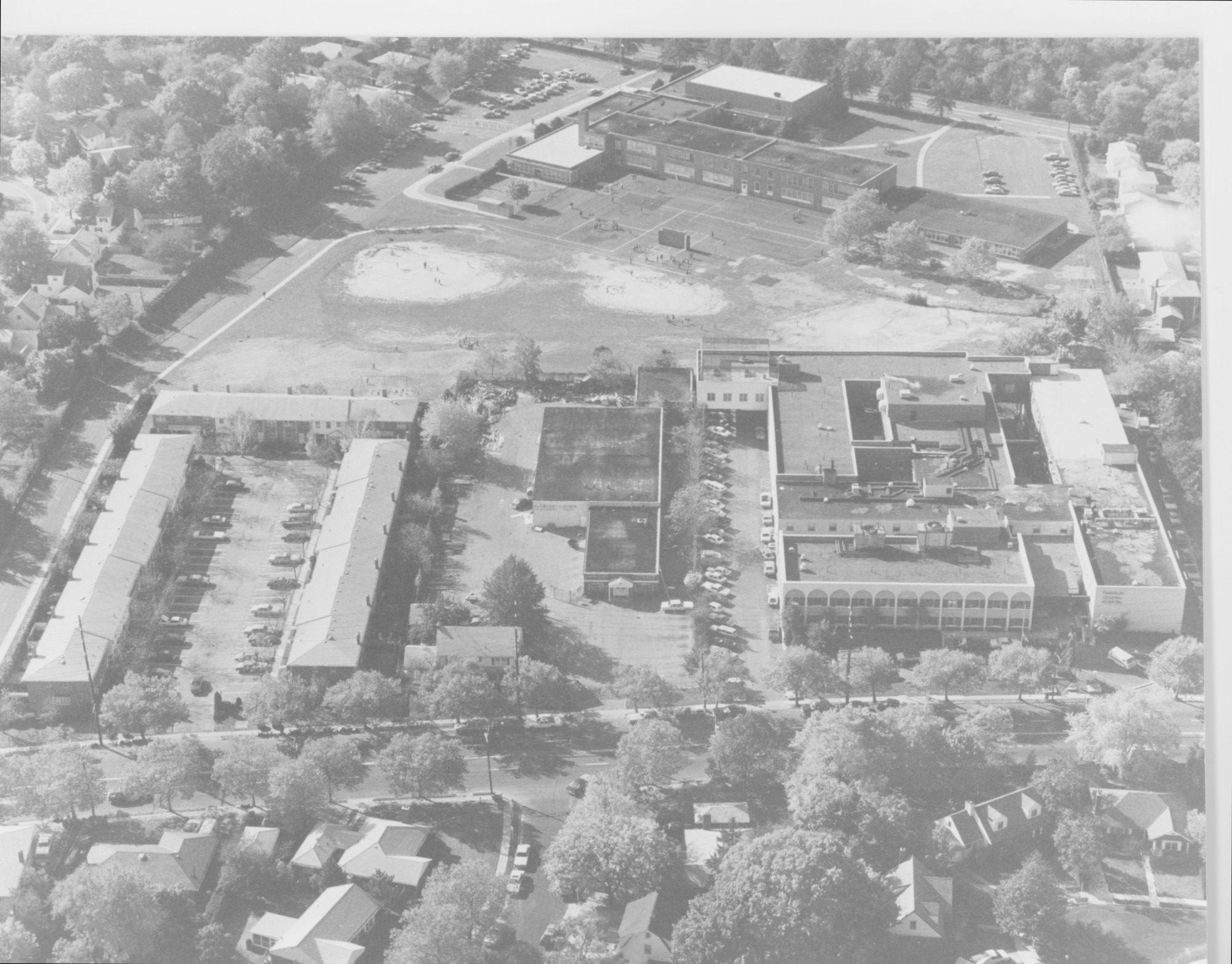 Franklin Hospital, at right, as it appeared in the early 1980s. The lumber yard, to the left, was bought by the hospital and torn down to add a nursing home. The hospital also once tried to purchase the James A. Dever School, top of photo, and surrounding property in the rear so it could expand.