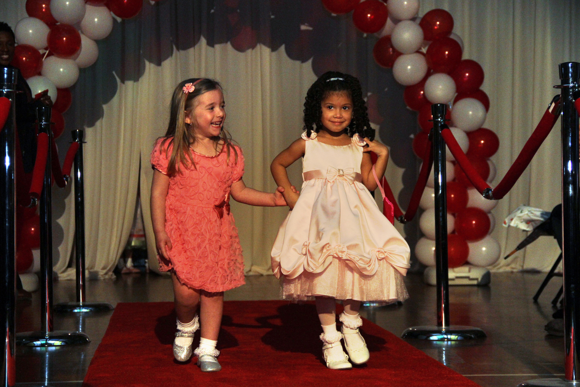 Rosann Passalacqua and Noell Crespo were models in Holy Name of Mary School's fashion show on April 12 in the auditorium.