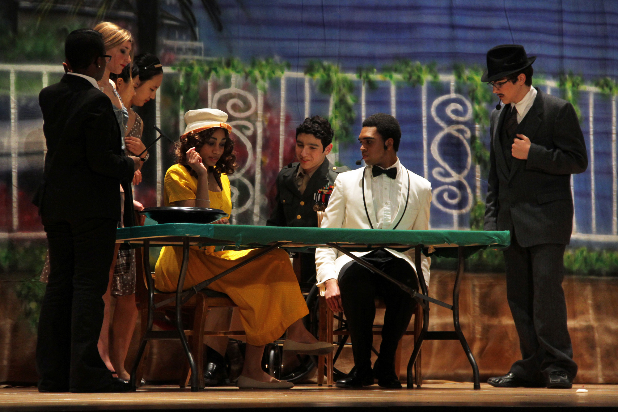 "LWA students performed the humorous ""Dirty Rotten Scoundrels."" At the table were Amber Garrick as Christine Colgate, Joshua Torres (Freddy Benson), Brandon Funderburke (Lawrence Jameson) and Brian Frost-LaPlante as Andre."