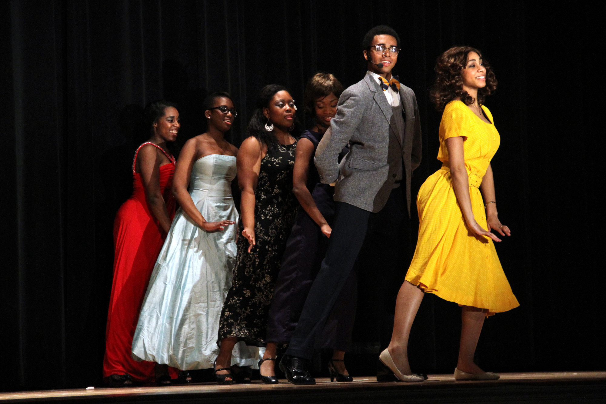 "The ensemble cast, performed the song ""The More We Dance."""