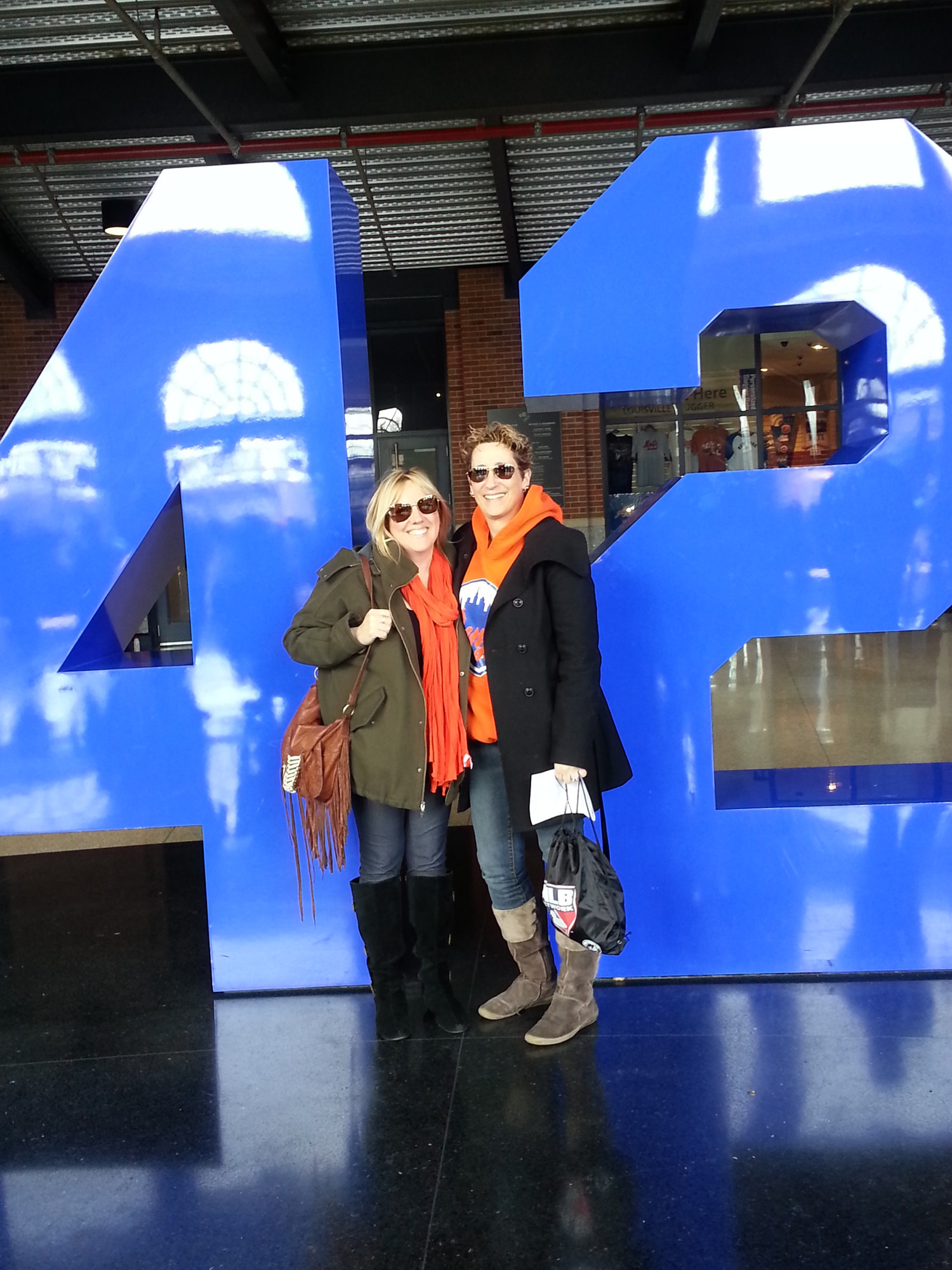 "Shari Dorfman and Ruth Rosenberg, fifth-grade teachers at Levy-Lakeside School in Merrick, attended a New York Mets game at Citi Field. The ""42"" statute in the background memorializes Jackie Robinson, who wore the number and is one of the historical figures Dorfman and Rosenberg teach their students about as an example of 'how one person can make a difference.'"