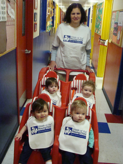 "The babies took A stroller ride, and sported their ""Week of the Young Child"" bibs."