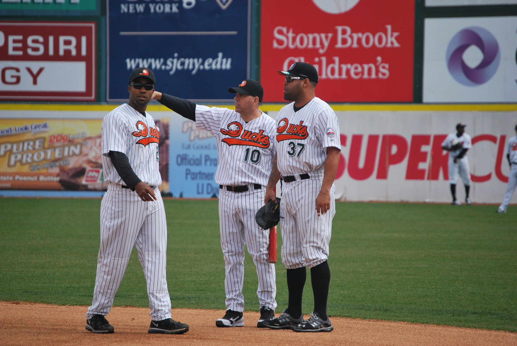 Ducks manger Kevin Baez, center, seeks to point players such as Josh Barfield, left, and Ramon Castro to another Atlantic League championship.