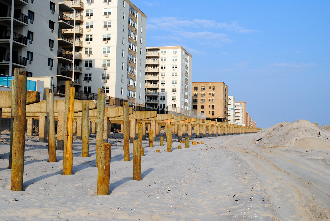 City officials say that the costs of rebuilding the Long Beach boardwalk are �unique,� while a number of residents say that the project's costs are exorbitant compared to other boardwalk projects.