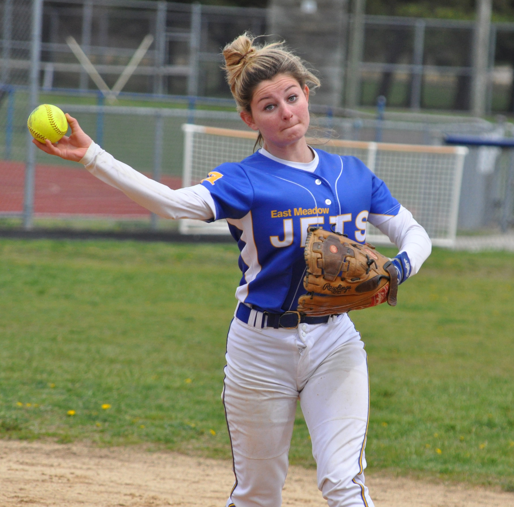 East Meadow's Ariel Cornfield, who homered in last Saturday's 7-6 loss to MacArthur, fires the ball to first base to record an out in the fourth inning.