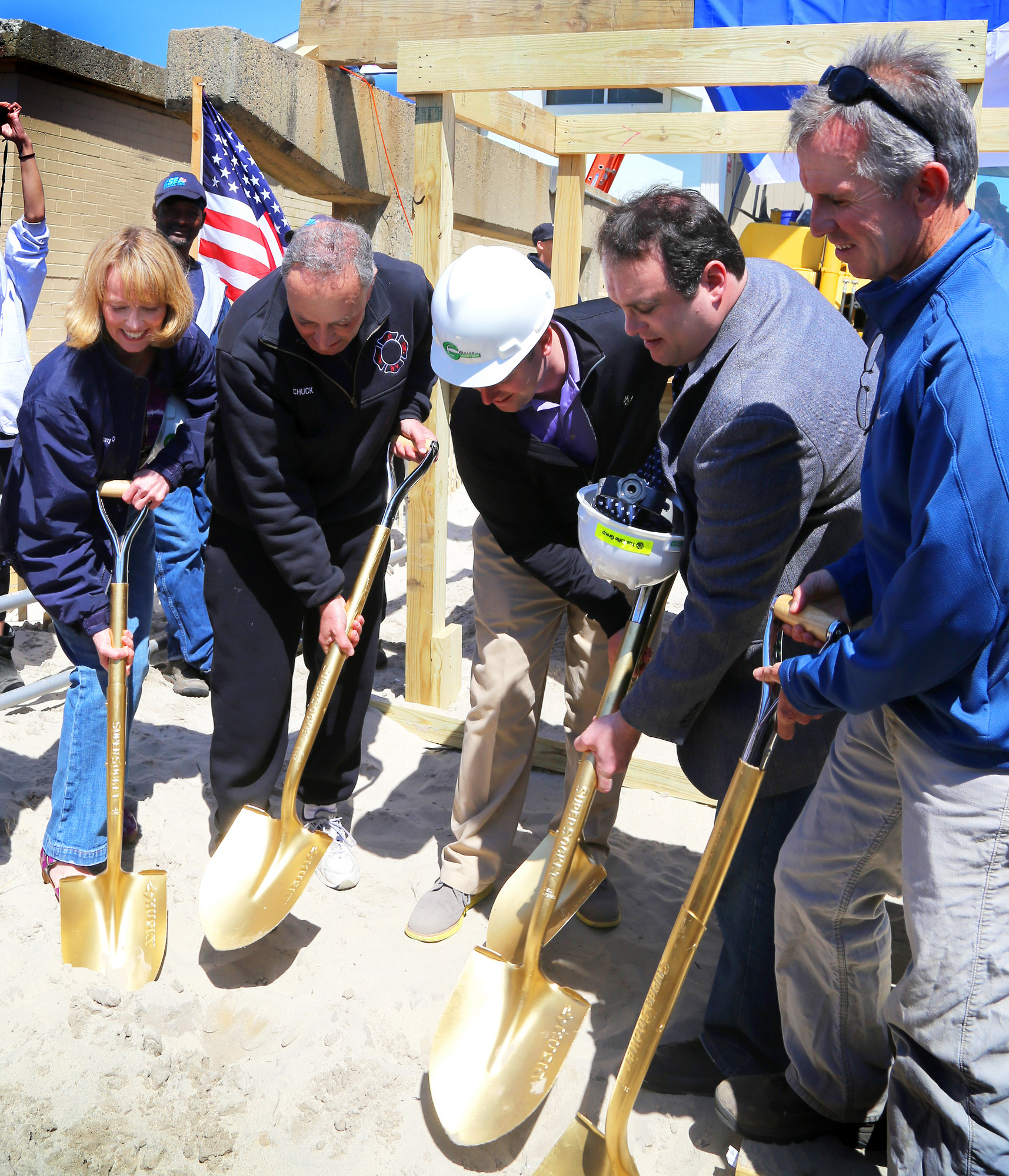 Councilwoman Eileen Goggin, left; Senator Charles Schumer; Bill Haughland, project manager of Grace Industries; City Council President Scott Mandel and Councilman John McLaughlin officially broke ground on a new boardwalk on Saturday.