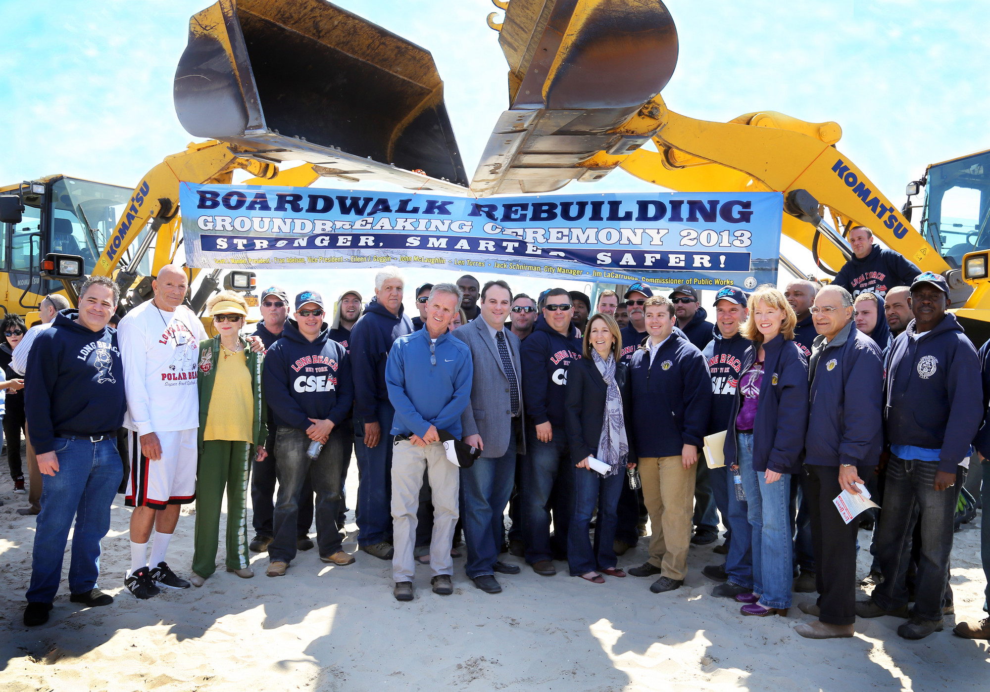 Officials and residents and city workers at Saturday's boardwalk groundbreaking ceremony.