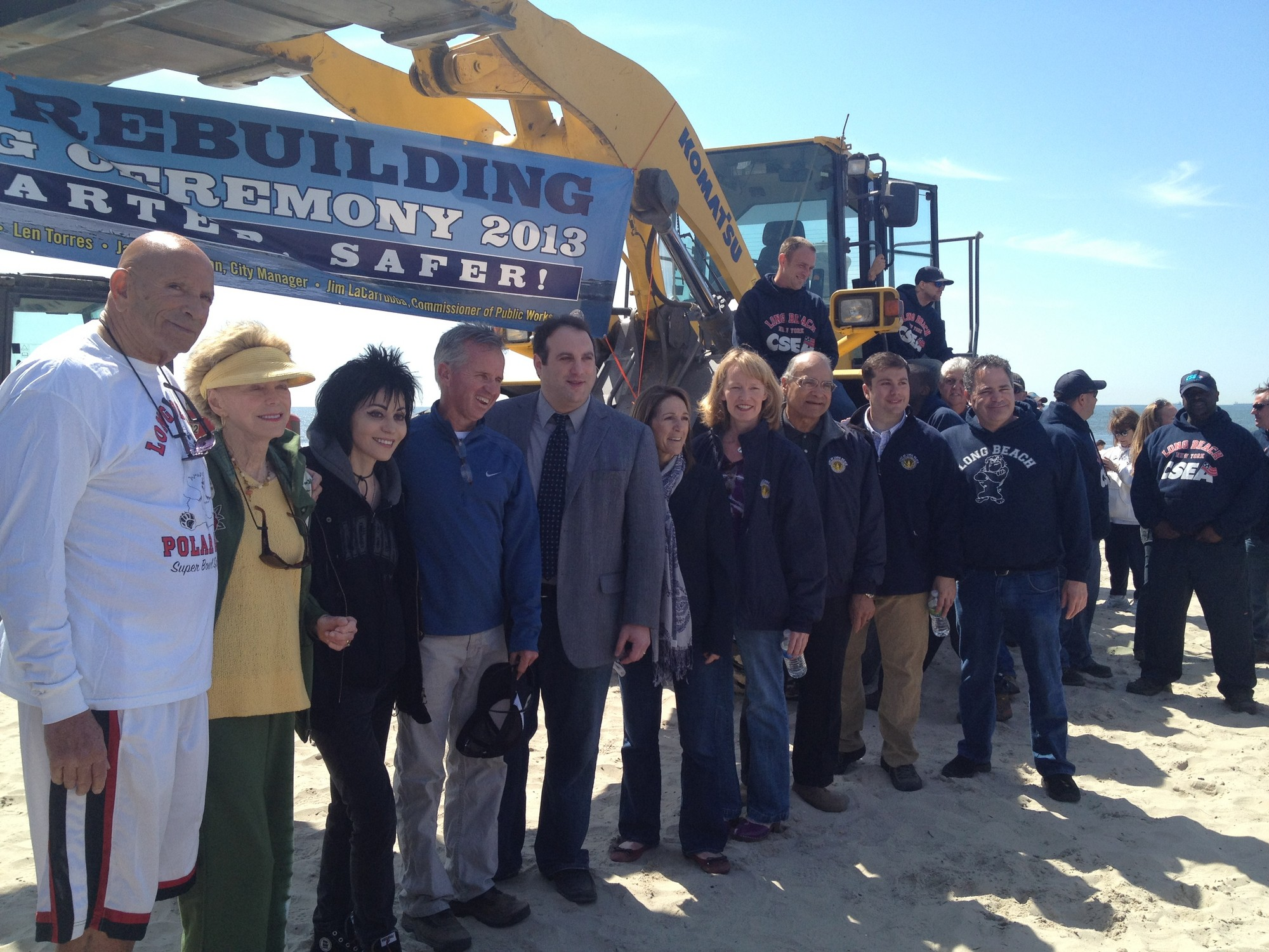 Officials at the boardwalk ceremony.