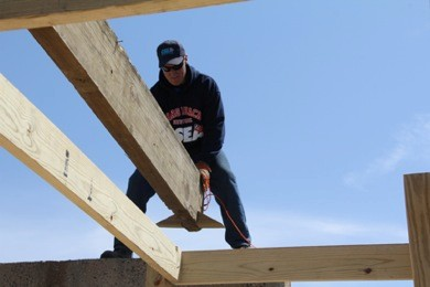 Chris Morrisey places the first beam on to the boardwalk. He has worked on the boardwalk for the last 32 years.