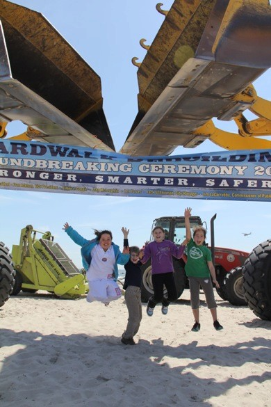 Lara Schenck, Noah Robinson, Julianne Robinson and Allison Cohen jump for joy knowing that the boardwalk is coming back and that the beach will be open for the summer