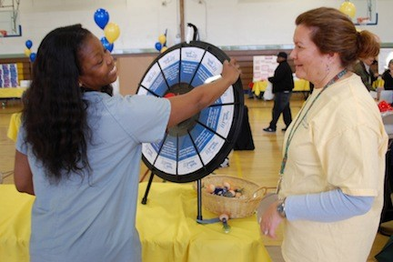 Dr. Mollie Williams spun the wheel to learn some facts about Franklin Hospital from nurse Diane Ino-Abbott.