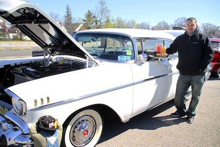 Jaime Rivera took a break for food beside his 1957 Chevrolet Bel Air.
