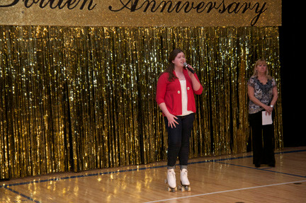 Emma McLaughlin sings the Star Spangled Banner at the DOCA 50th golden anniversary show with Introductions by recreation assistant Nancy Baxter, in rear.
