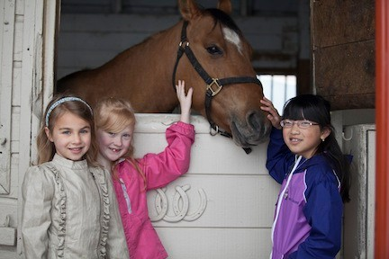 Ava Karpowitz, 7, Samanth Kapuano, 7, and Kimberly Wong, 7, all from Lynbrook pick a favorite horse.