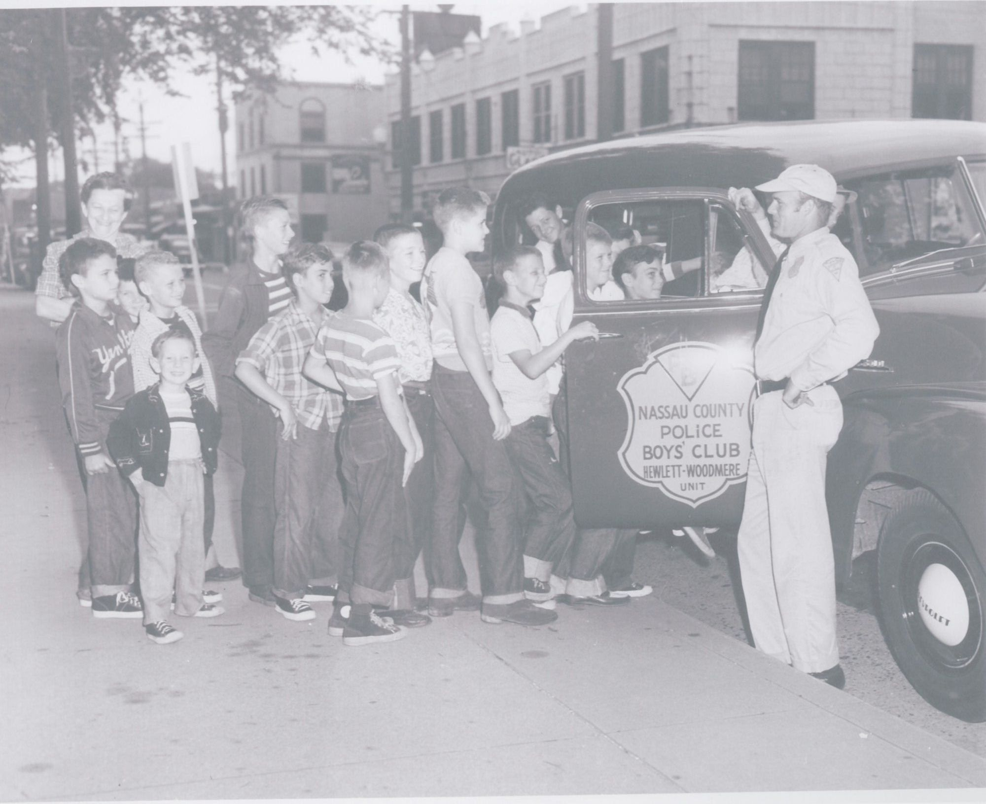 At Broadway and Hartwell Place in Woodmere in the 1950s, children got a look at Harold Sammis' patrol car.