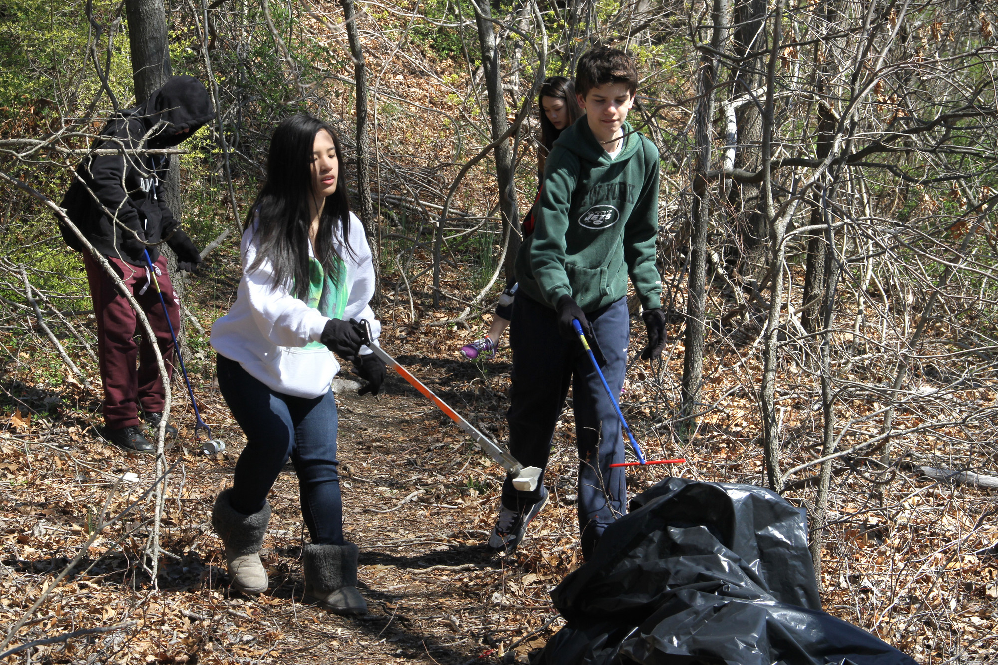 Approximately a ton of garbage was picked up during the cleanup. Hewlett High School students Zeke Malaney, Ali Pilao and Reiner Scherzinger pitched in.