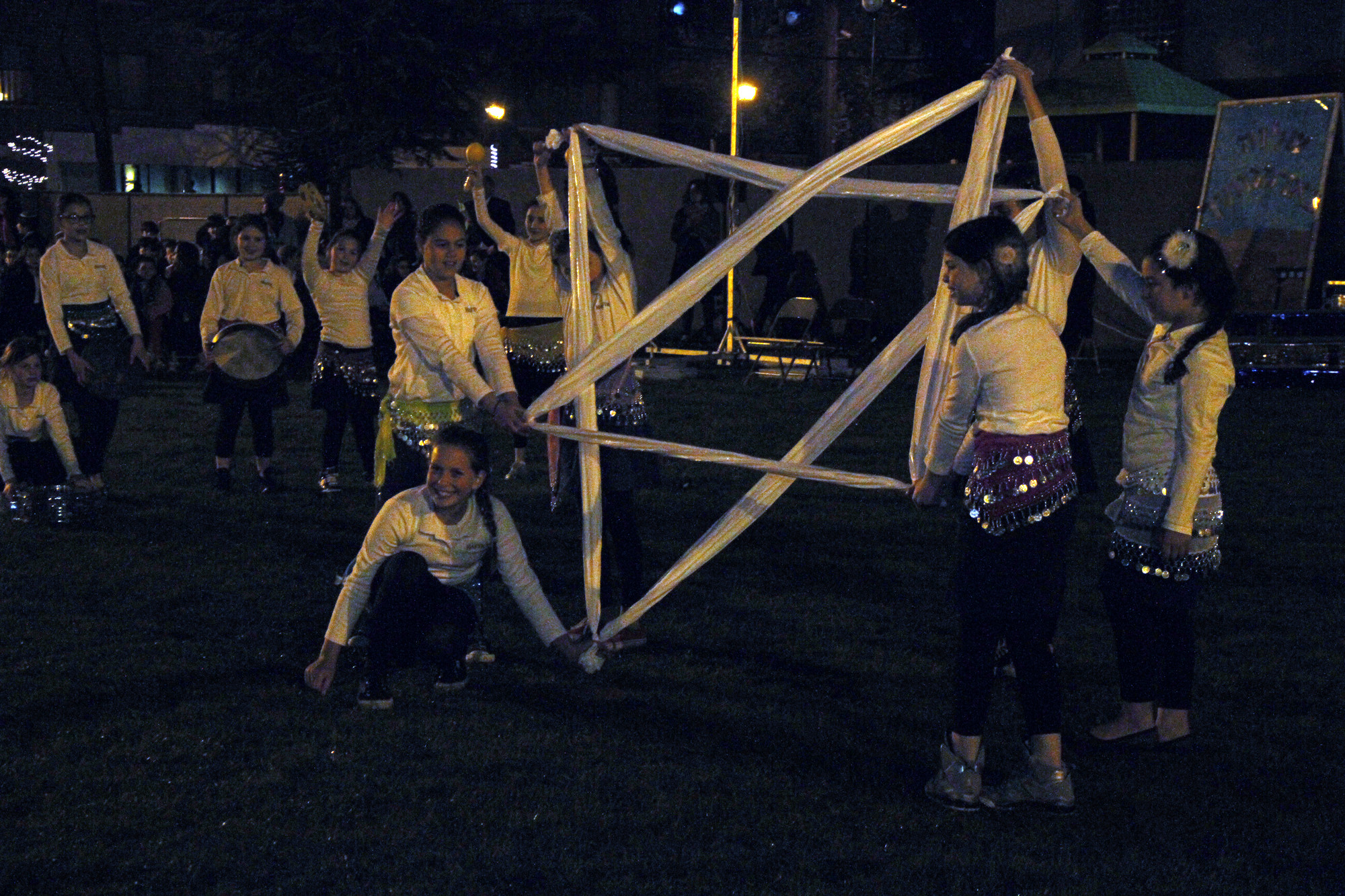 Students hold a Star of David during HAFTR's night time event that marked Israel's 65th anniversary.
