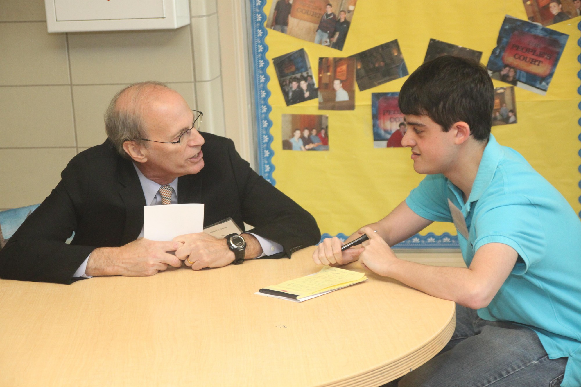 Honoree Jeffrey Bader is interviewed by Hewlett High Spectrum newspaper reporter Michael Green.