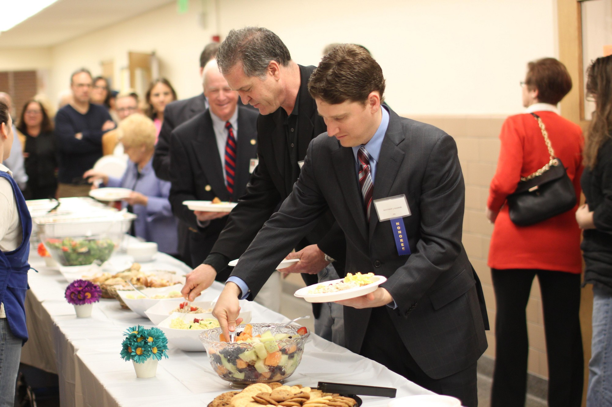 At the induction ceremony brunch, honoree Matthew J. Bassiur added some fruit to his food plate.
