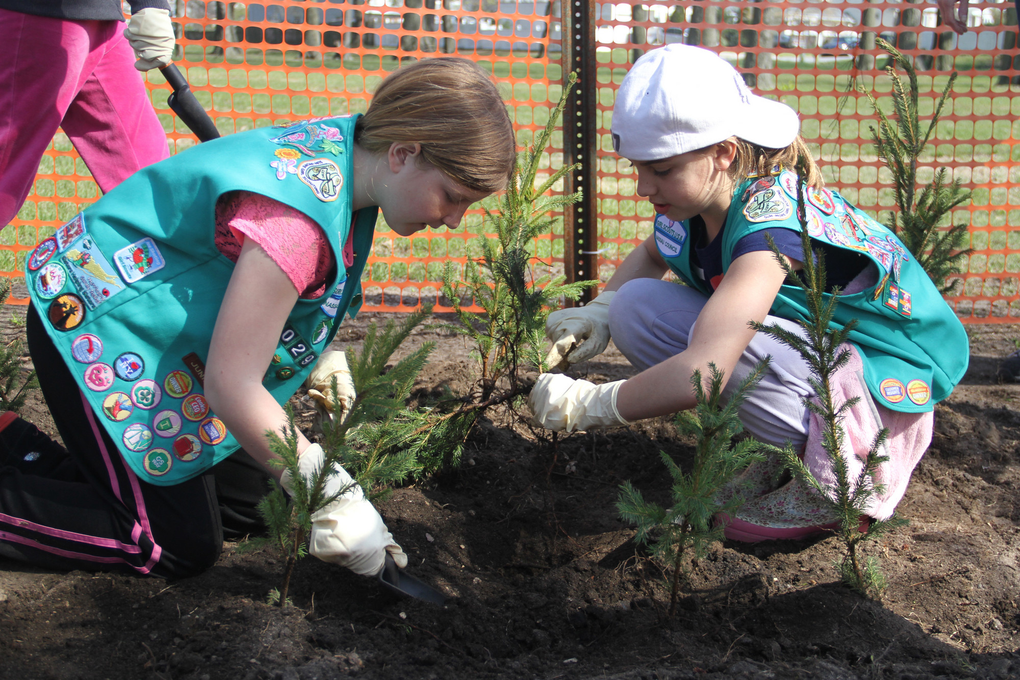 Bridget Sharp and Emerald Fogerty of Girl Scout Troop 2029 planted a tree.