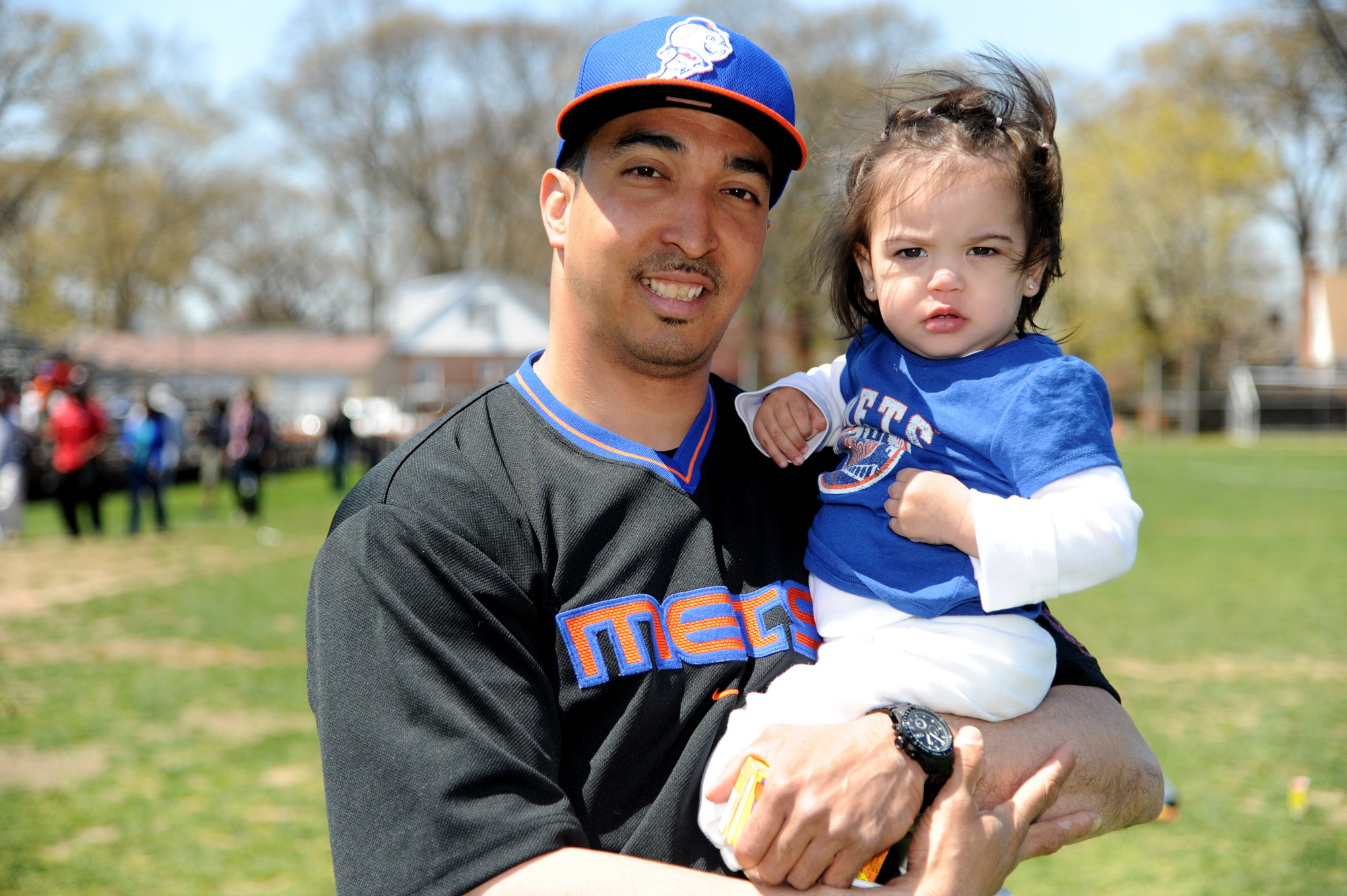 Baseball fans Johnny Torres and his daughter Sydney Page Torres, 2, enjoyed the sunny day.