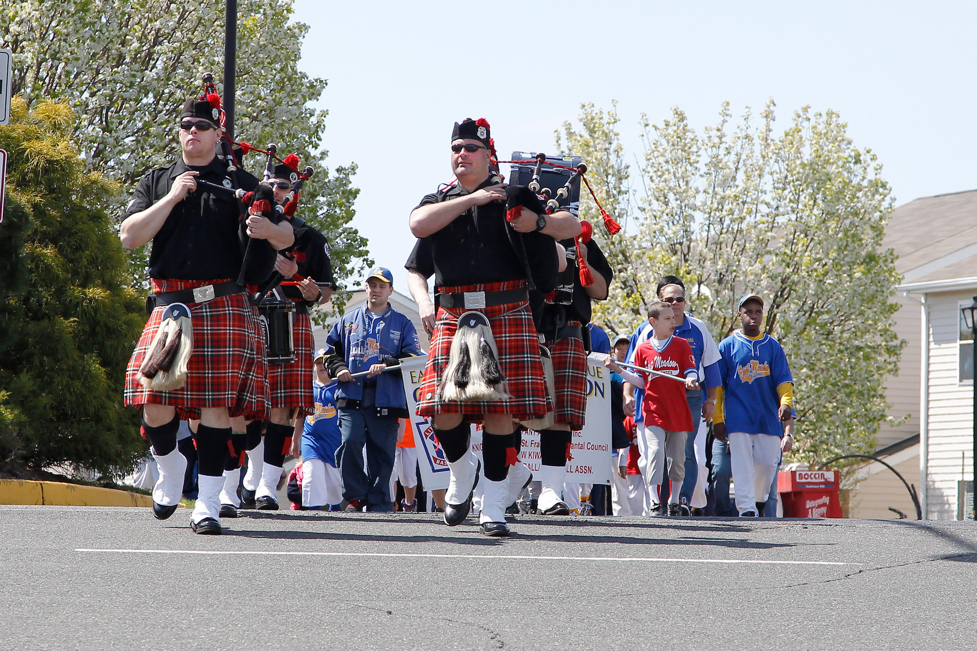 The Nassau County Firefighters Bag Pipes and Drum Corps and the Challenger Division players led the East Meadow Baseball Softball Association parade as it entered the ball field complex on Merrick Avenue.