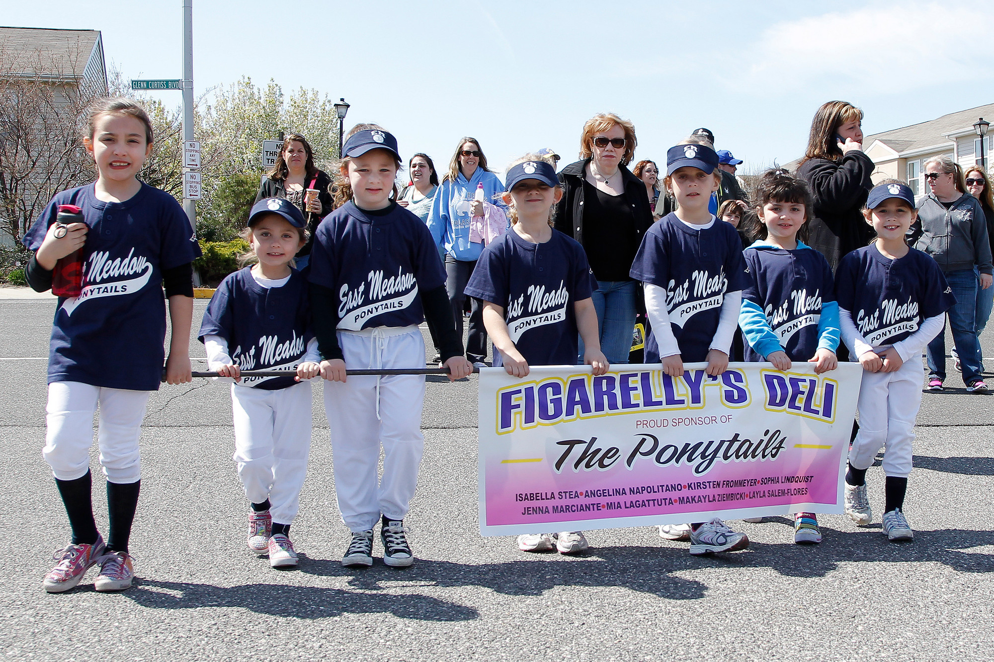 The East Meadow Ponytails team, sponsored by Figarelly's Deli, was one of many teams who gathered together and marched during the East Meadow Baseball Softball Association's annual parade.