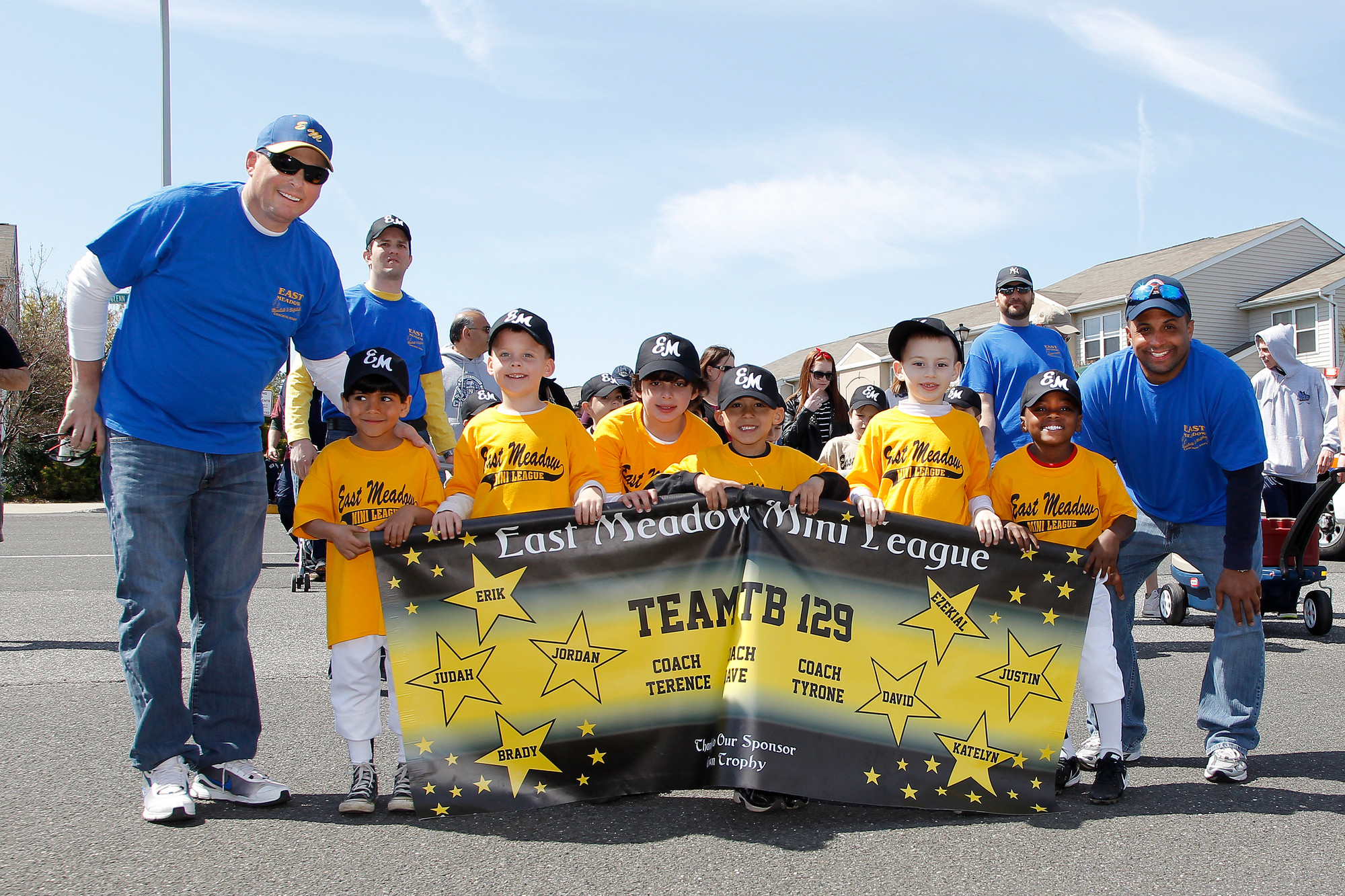 The East Meadow Tee Ball Team No. 129 marched the parade with their coaches.