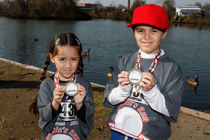 Maria and William Vetell with their medals at Robbie's Run.