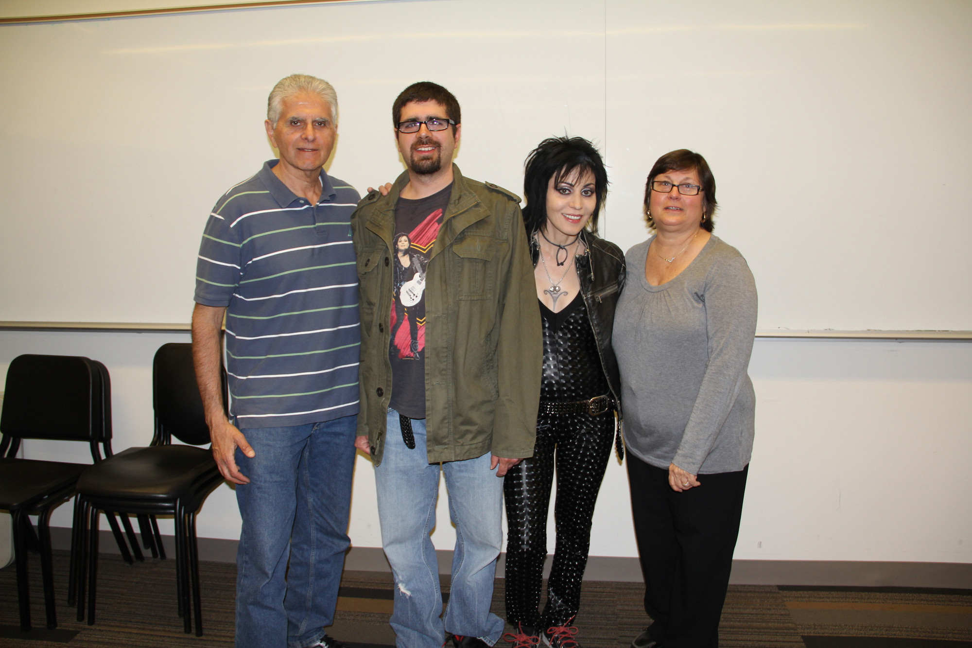 Angelo Maroulis, with his son Angelo and wife Cathy, met with Joan Jett before her concert at Molloy College's Madison Theatre.