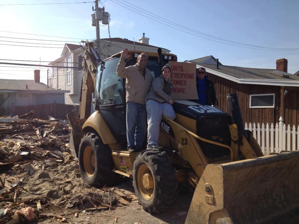 West End resident Sam Kinsley, far right, demolished her Sandy-damaged home on Pennsylvania Avenue in April.