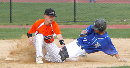 Carey's Nick Zuvic, left, slaps down a tag during its 4-2 win over Herricks.
