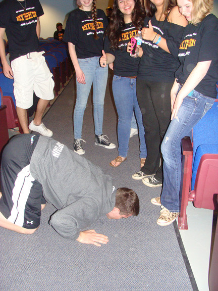 High school senior Billy Humes followed through on his promise to kiss the floor of the school when he got back.