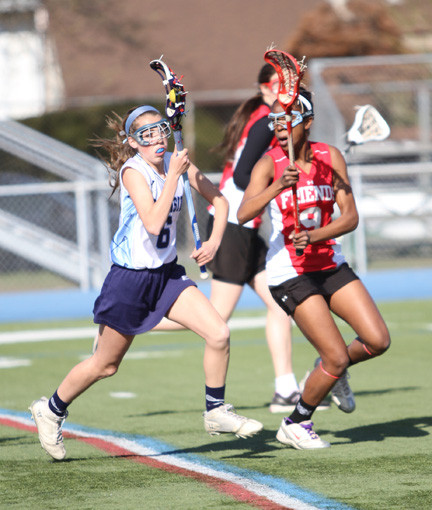 Oceanside's Cassie Cesario, left, provided the heroics in a 16-15 win over Friends Academy on April 25, scoring late in regulation and in triple OT.
