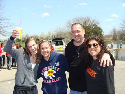 Celebrating together: Kiersten Cote, left, with friend Rachael Putelo and Kiersten�s parents Chris and Jill Cote.