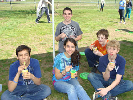 A group of Junior High students enjoyed their Italian ices.