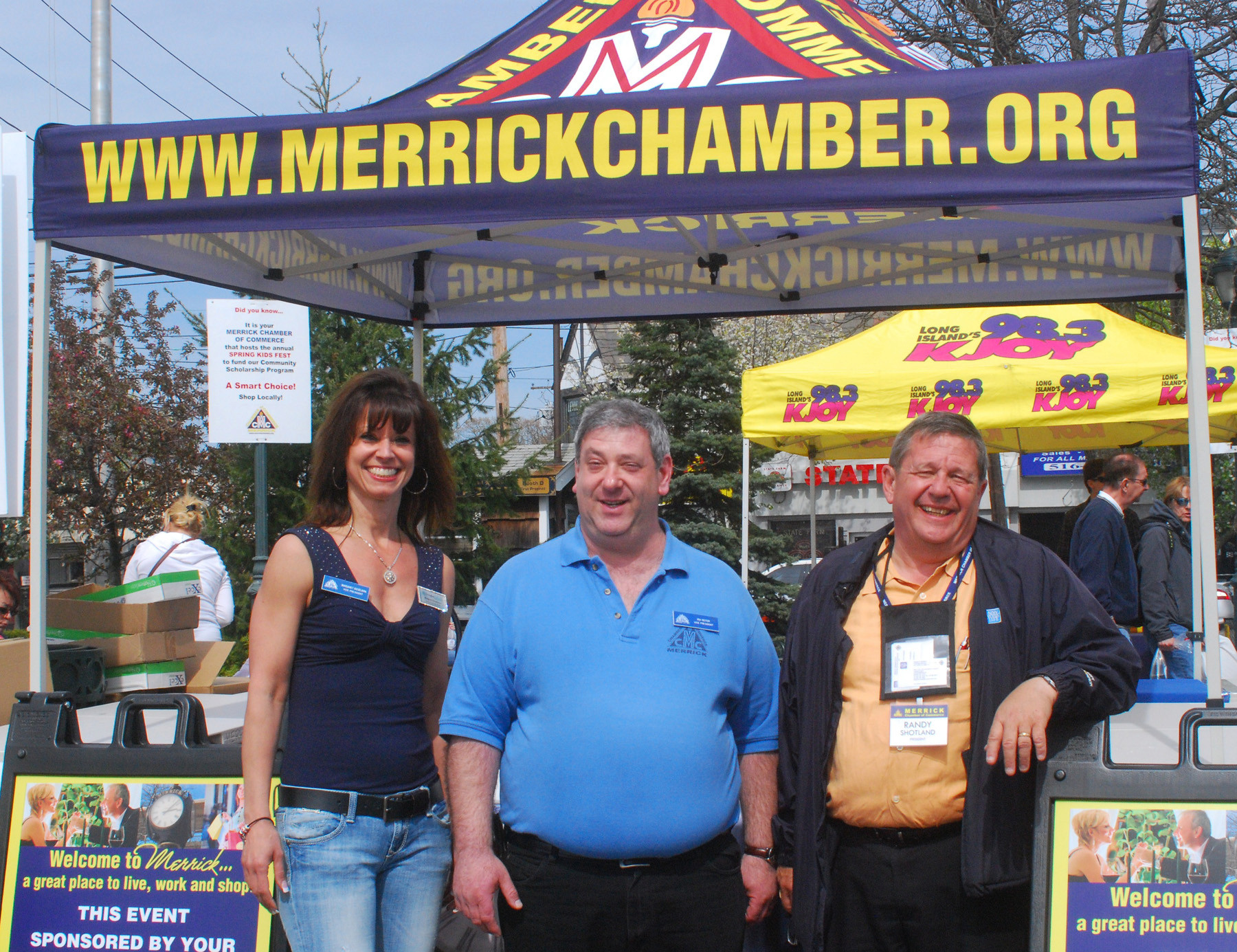 Margaret Biegelman, Ira Reiter and Randy Shotland of the Merrick Chamber of Commerce welcomed visitors to the festival.