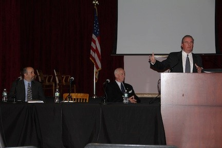 Jim Johnson, at the lectern, with David Shereck, far left, and Bernie Shereck, represented New York Sports and Entertainment LLC.
