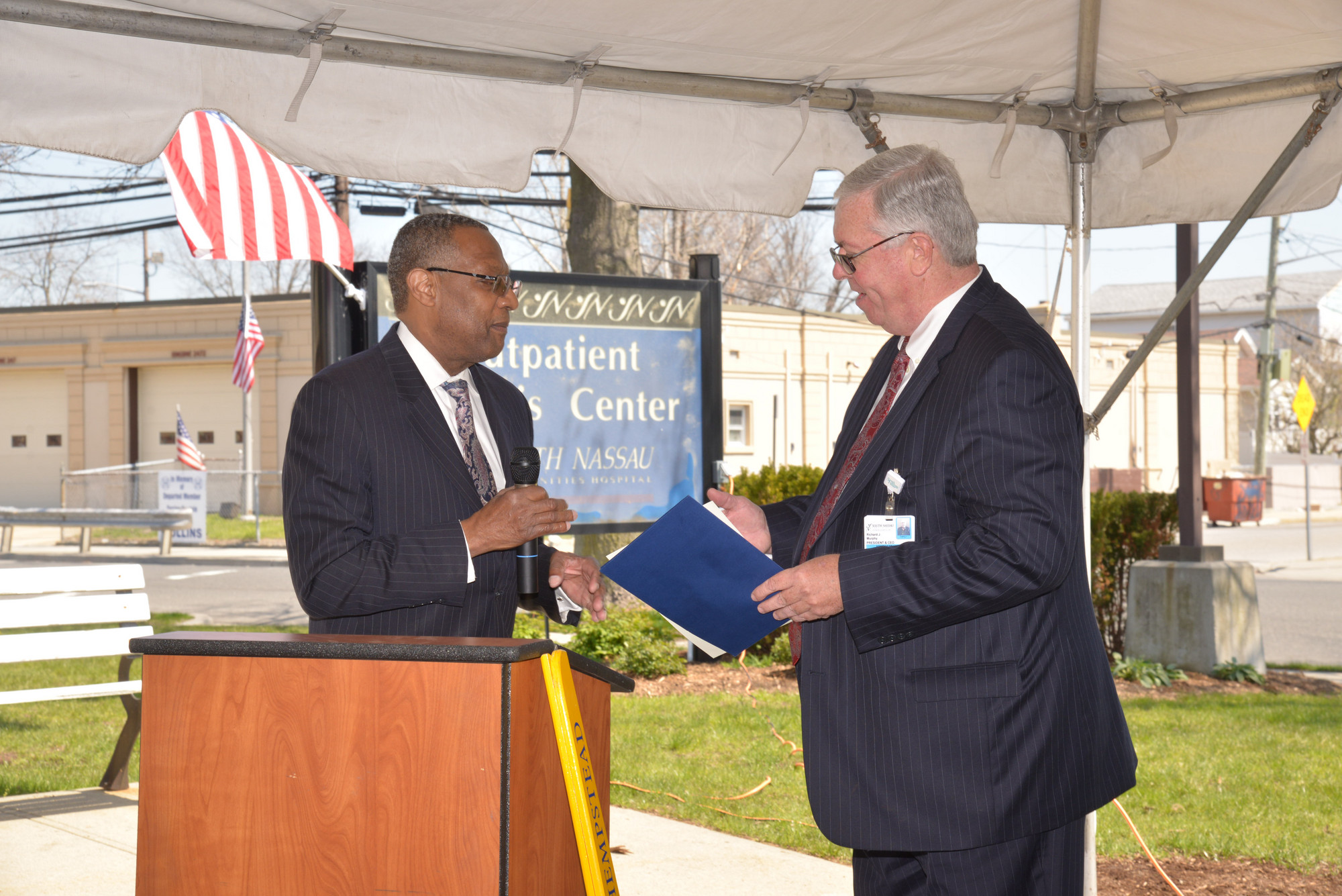 Wayne Hall, (left) the mayor of Hempstead and a patient at the dialysis center, spoke with CEO Murphy