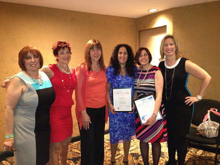 Award winners, from left, co-president Carol Konecky, Sharon Hochhauser, Madeline Winn, Lisa Shapiro, Sharon Guskin and co-president Deborah Smith.