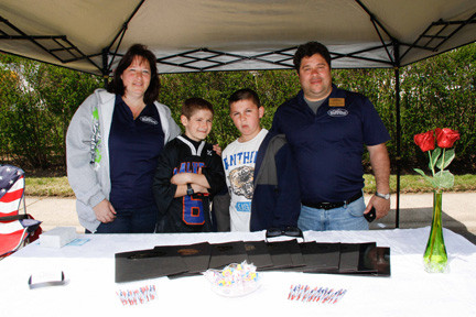 At the street fair, from left, Hilda Manuella, Matthew Barnett, Nick Garrone,  and Robert Manuella, the president of the West Hempstead chamber of commerce.