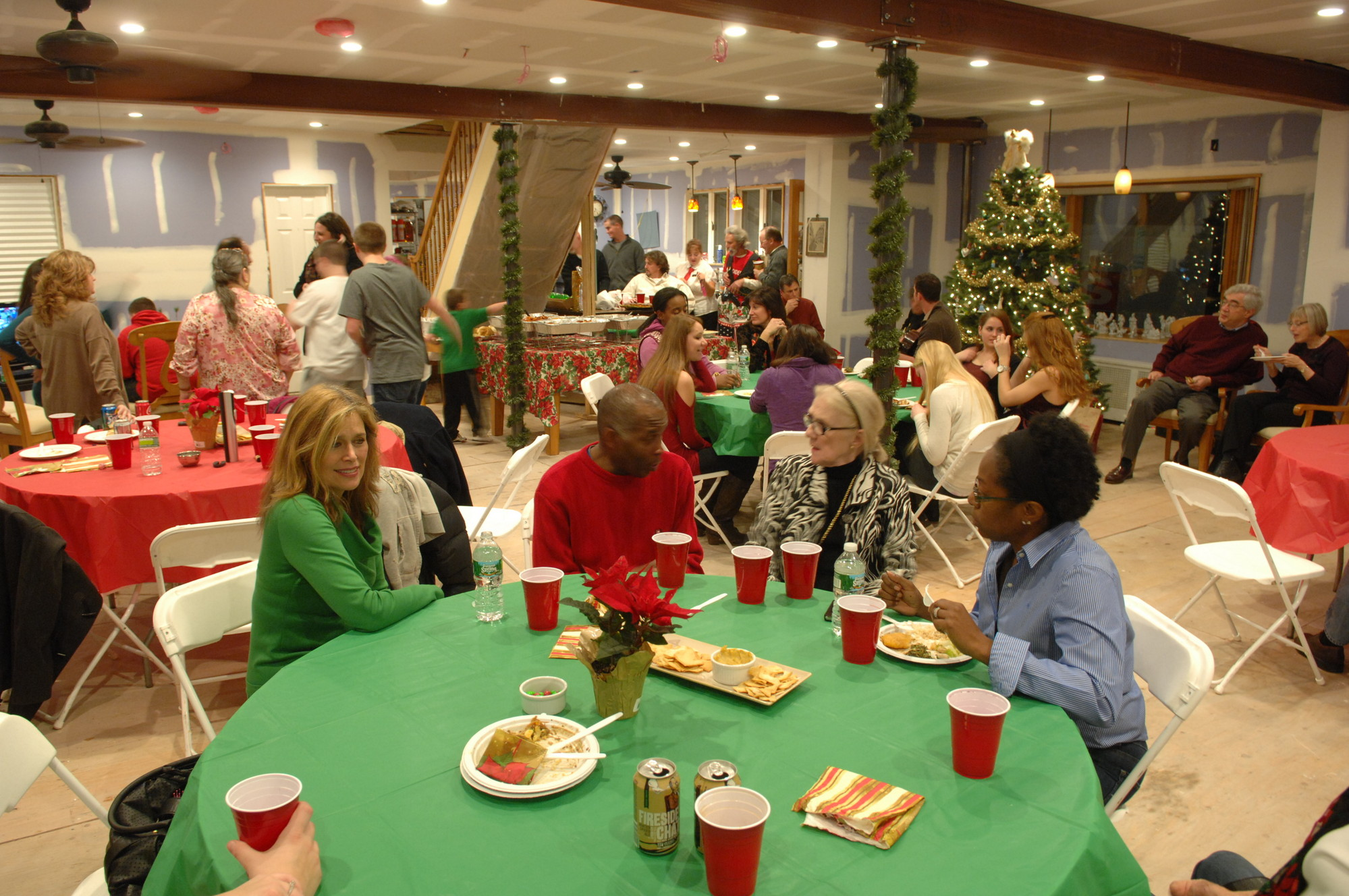 A holiday party for Harbor Court Road was held at the Kennedy house this year because most homes in the neighborhood were still too badly damaged.