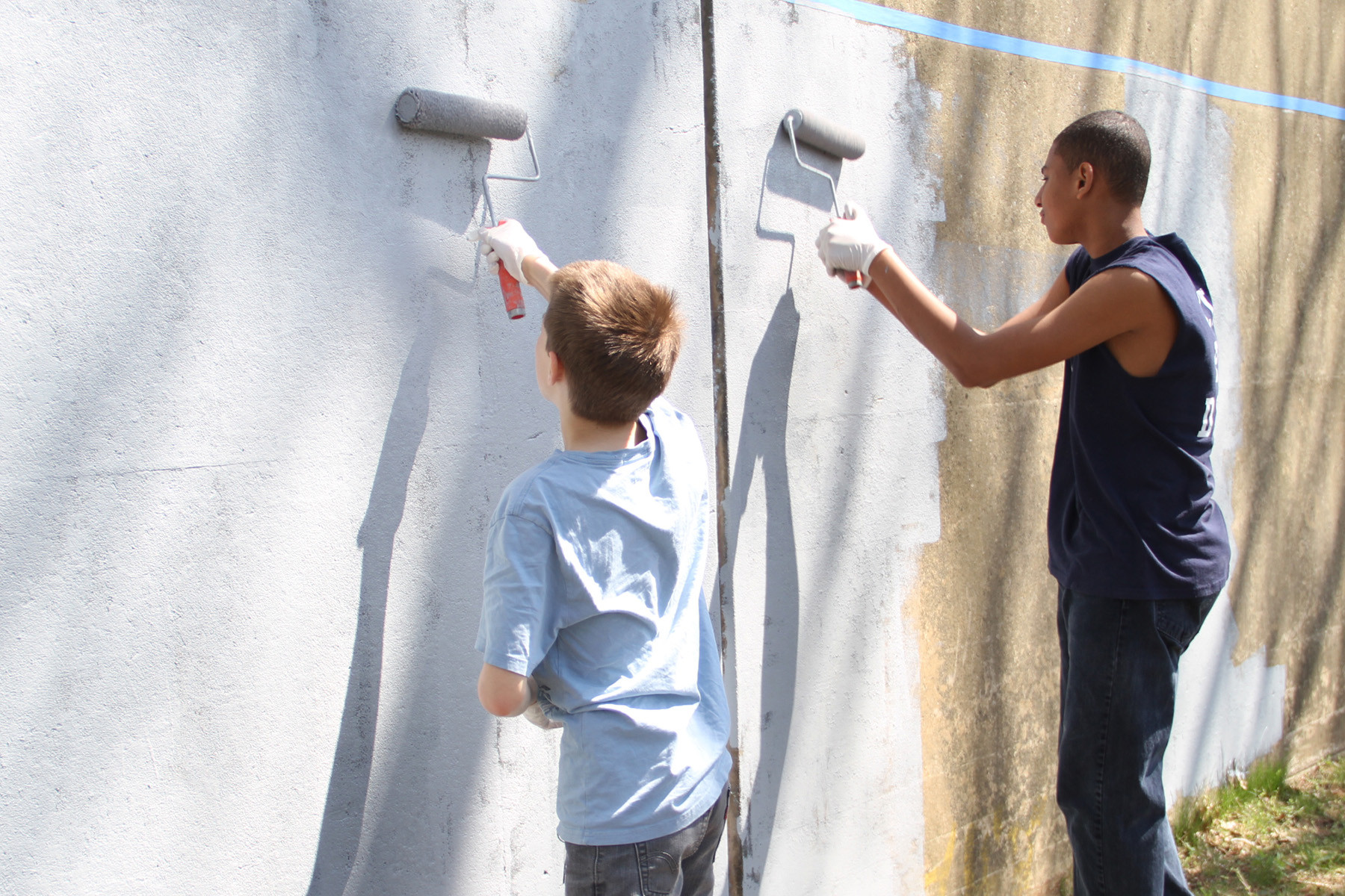 Volunteers from Envision Valley Stream painted the Long Island Rail Road trestle wall on April 28.