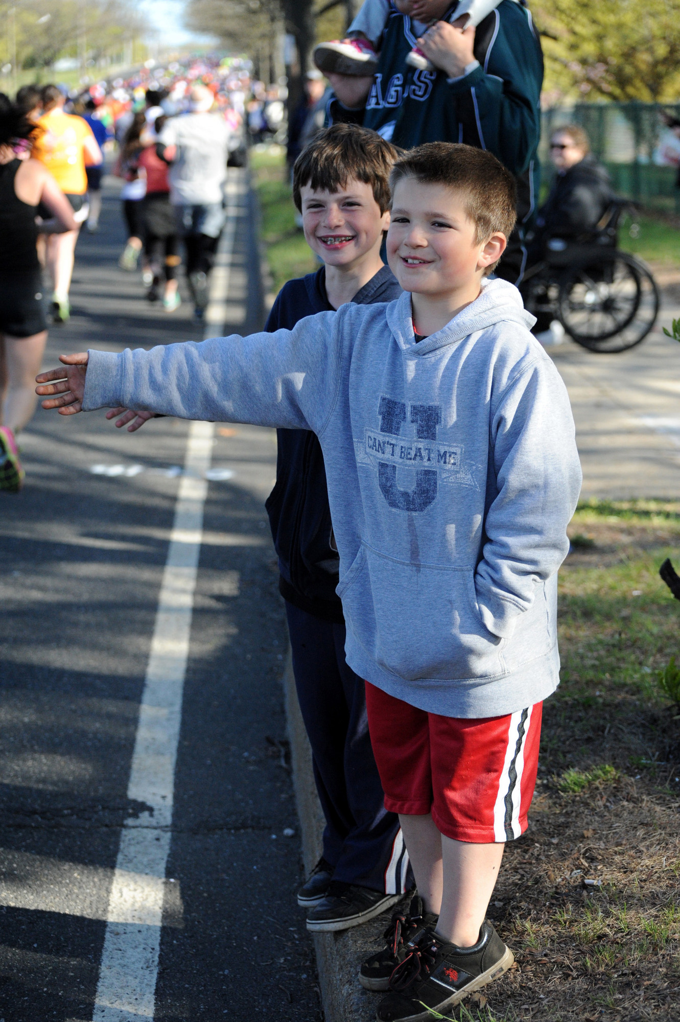 Sean Smith and Logan Schwartz, both 8, were two of 25,000 spectators who came out to support the runners.