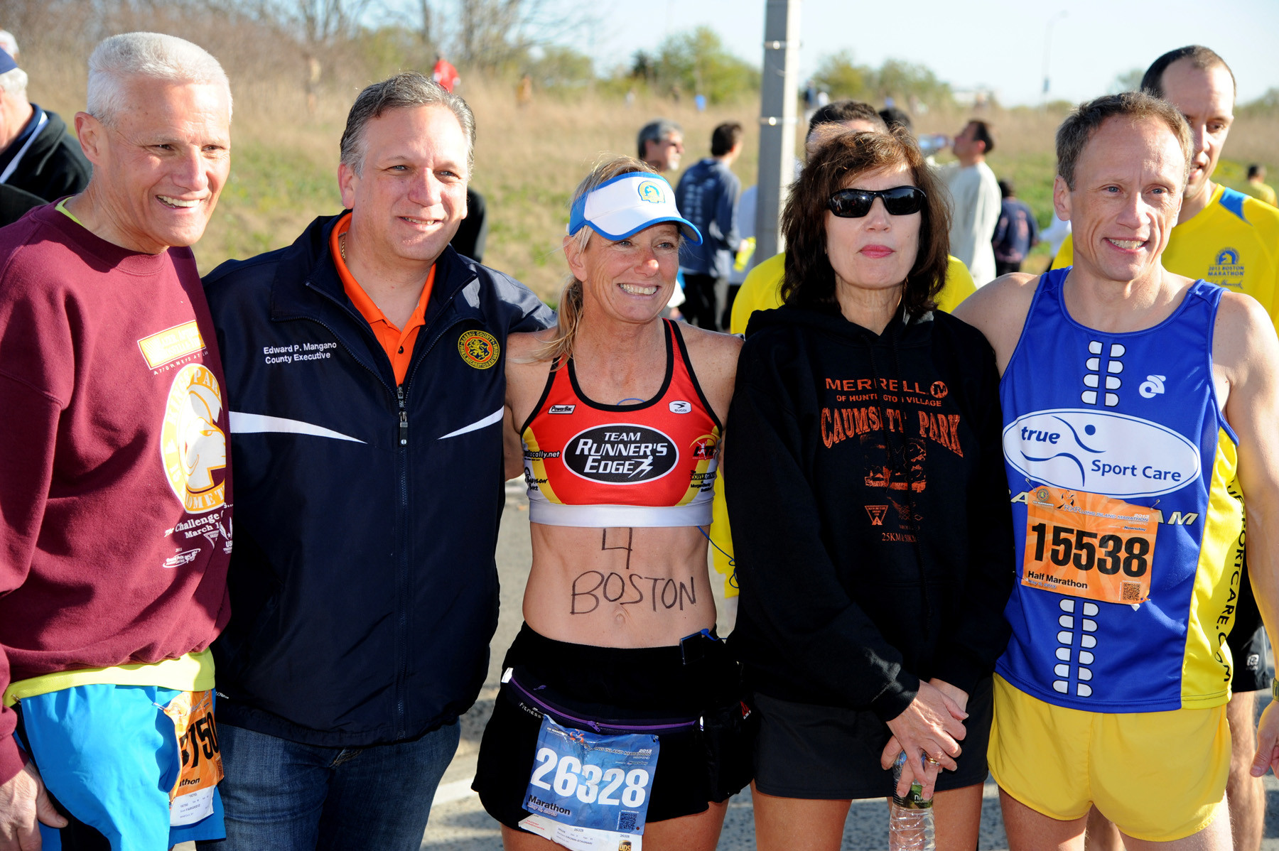 Prior to last Sunday's Long Island Marathon, a tribute was held to honor the victims of the Boston Marathon. Pictured is County Executive Ed Mangano, second from left, with runners who participated in the Boston race, including, from left, Scott Fairgrieve, Barbara Cronin, Linda Ottaviano and Will Widman.