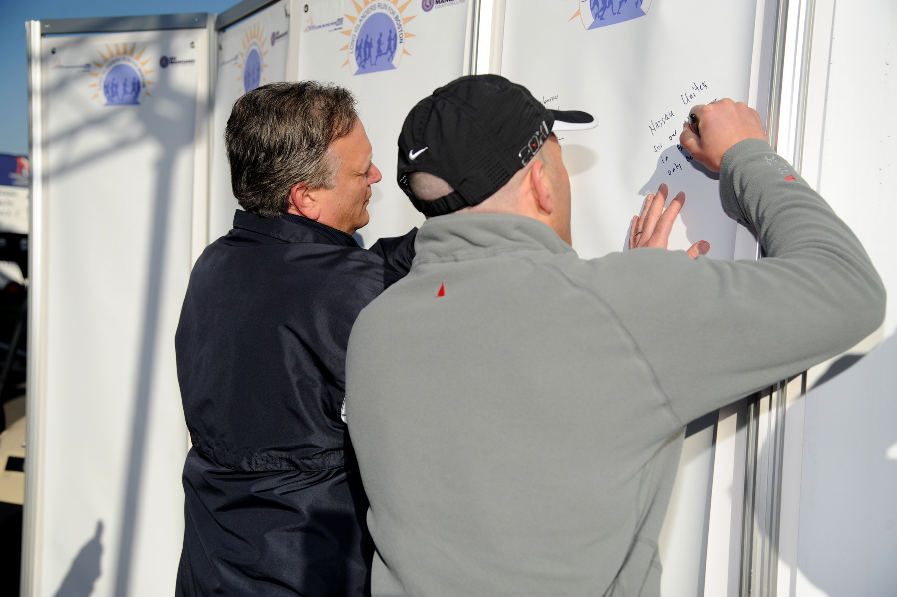Mangano and RXR Realty CEO Scott Rechler, the title sponsor of the marathon, signed a 70-square-foot banner, which will be shipped to Boston.