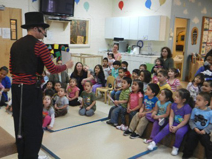 Anna House children watched intently and listened closely as the magician put on a thrilling show.